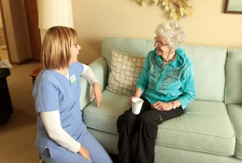 nurse and senior talking